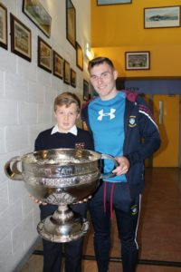 Harry Niall with Westmeath County player Kieran Martin and Sam Maguire